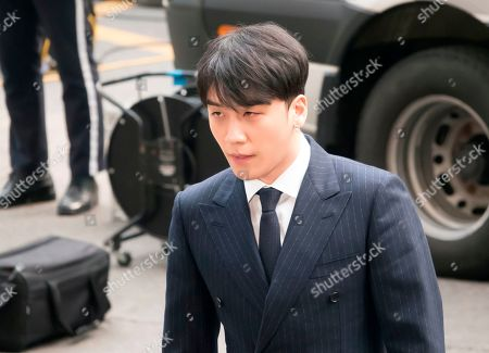 Lee Seung-hyun, a member of K-pop boy band BIGBANG, arrives at the Seoul Metropolitan Police Agency for police questioning over sex-for-favors allegations in Seoul, South Korea.