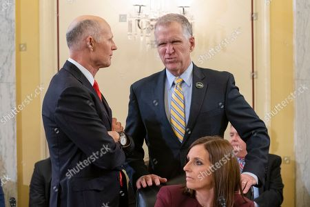 Thom Tillis, Rick Scott, Martha McSally. Sen.Thom Tillis, R-N.C., center, speaks with Sen. Rick Scott, R-Fla., left, and Sen. Martha McSally, R-Ariz., below, before a Senate Armed Services subcommittee hearing on Capitol Hill in Washington. Tillis has said he will vote to block President Donald Trump's border emergency as some GOP senators plan to join Democrats in a rebuke of Trump's declaration of a national emergency at the Mexican border
