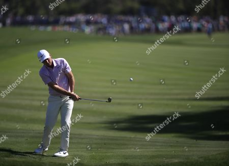 Russell Henley of the US chips on the ninth hole during the first round of THE PLAYERS Championship golf tournament on the Stadium Course at TPC Sawgrass in Ponte Vedra Beach, Florida, USA, 14 March 2019. The tournament runs from 14 to 17 March.