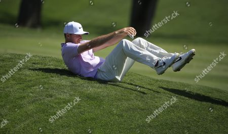 Russell Henley of the US flops down to sit on the  ninth hole during the first round of THE PLAYERS Championship golf tournament on the Stadium Course at TPC Sawgrass in Ponte Vedra Beach, Florida, USA, 14 March 2019. The tournament runs from 14 to 17 March.