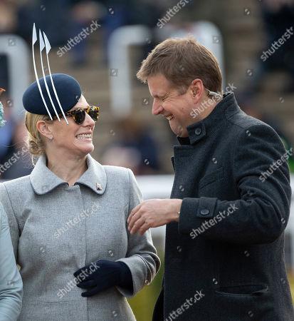 Zara Tindall and ITV racing presenter Ed Chamberlin joke together.