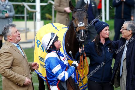 Stock Image of Bryony Frost with Frodon after victory in the Ryanair Chase at Cheltenham. Also pictured l-r Paul Nicholls, lass Michelle Kramer and owner Paul Vogt [right].