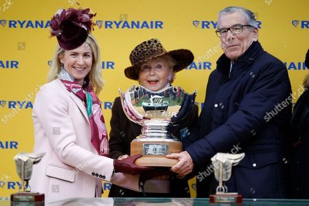 Anita O'Leary presents to Paul Vogt and his wife after Frodon had won the Ryanair Chase at Cheltenham.