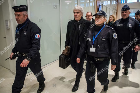 French tycoon Bernard Tapie (C) arrives at the Tribunal de Paris courthouse for the fourth day of his trial, in Paris, France, 14 March 2019. French businessman Bernard Tapie goes on trial over a compensation of 404 million euros in 2008, to settle a long-running legal dispute following a fraught 1993 corporate deal regarding the sale of his sportswear company Adidas. The case involves Christine Lagarde, now head of the International Monetary Fund (IMF) but at the time Finance minister of Nicolas Sarkozy's government, and her former chief of staff, Stephane Richard, now chief executive of Orange, among others.