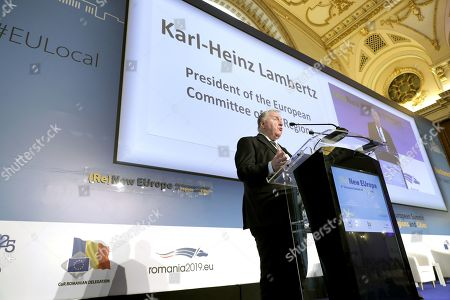 Stock Image of The President of the European Committee of the Regions Karl-Heinz Lambertz delivers a speech at the opening session of the 8th European Summit of Regions and Cities called '(Re)New - EUrope' held at the Romanian parliament Headquarters in Bucharest, Romania, 14 March 2019. The 8th European Summit of Regions and Cities is gathering all the EU national, local and regional leaders from across Europe to discuss the future of the European Union. According to the schedule, at the end of the summit a declaration by local and regional leaders on the future of Europe will be adopted in order to share their voice ahead of the European elections.
