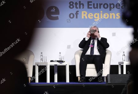 President of the European Committee of the Regions Karl-Heinz Lambertz takes a photo during the opening session of the 8th European Summit of Regions and Cities called '(Re)New - EUrope' held at the Romanian parliament Headquarters in Bucharest, Romania, 14 March 2019. The 8th European Summit of Regions and Cities is gathering all the EU national, local and regional leaders from across Europe to discuss the future of the European Union. According to the schedule, at the end of the summit a declaration by local and regional leaders on the future of Europe will be adopted in order to share their voice ahead of the European elections.