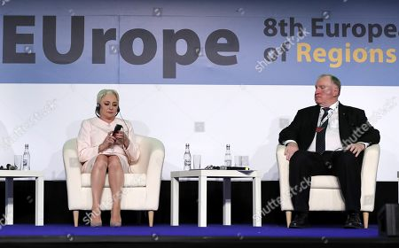 President of the European Committee of the Regions Karl-Heinz Lambertz (R) and Romanian Prime Minister Viorica Dancila (L) attend the opening session of the 8th European Summit of Regions and Cities called '(Re)New - EUrope' held at the Romanian parliament Headquarters in Bucharest, Romania, 14 March 2019. The 8th European Summit of Regions and Cities is gathering all the EU national, local and regional leaders from across Europe to discuss the future of the European Union. According to the schedule, at the end of the summit a declaration by local and regional leaders on the future of Europe will be adopted in order to share their voice ahead of the European elections.