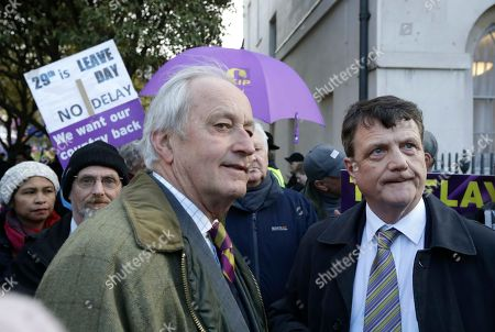 Stock Photo of UKIP leader Gerard Batten, right, and politician Neil Hamilton, join an anti-EU protest outside the Houses of Parliament in London,. British lawmakers faced another tumultuous day Thursday, as Parliament prepared to vote on whether to request a delay to the country's scheduled departure from the European Union and Prime Minister Theresa May struggled to shore up her shattered authority