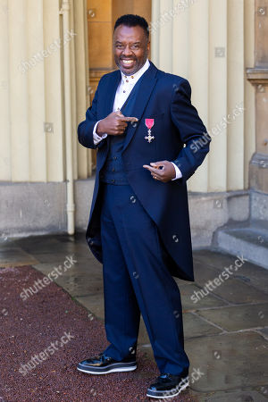 Musician David Grant proudly displays his OBE for services to music following an investiture ceremony at Buckingham Palace