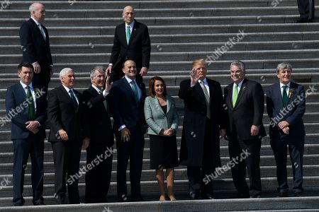 Stock Photo of Donald Trump, Matt Barrett, Mike Pence, Richie Neal, Leo Varadkar, Nancy Pelosi, Peter King, Daniel Mulhall. President Donald Trump, third from right, waves as he stands with, from front left, Matt Barrett, Vice President Mike Pence, Rep. Richard Neal, D-Mass., Irish Prime Minister Leo Varadkar, House Speaker Nancy Pelosi of Calif., Rep. Peter King, D-N.Y., and Ireland's Ambassador to the United States Daniel Mulhall, as he arrives on Capitol Hill in Washington, to have lunch