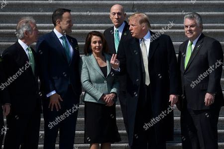 Donald Trump, Richard Neal, Leo Varadkar, Nancy Pelosi, Peter King, Paul Irving. President Donald Trump, second from right, talks with, from left, Rep. Richard Neal, D-Mass., Irish Prime Minister Leo Varadkar, House Speaker Nancy Pelosi of Calif., House Sergeant-at-Arms Paul Irving and Rep. Peter King, D-N.Y., as he arrives on Capitol Hill in Washington, for a luncheon