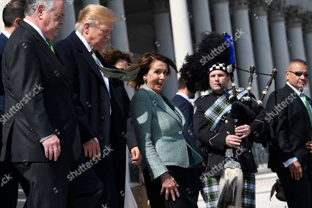 Donald Trump, Peter King, Nancy Pelosi. House Speaker Nancy Pelosi of Calif., center, walks with President Donald Trump, second from left, down the steps of the Capitol in Washington, following lunch with Irish Prime Minister Leo Varadkar. Rep. Peter King, D-N.Y., is at left