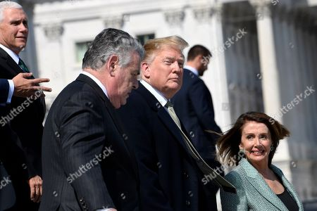 Donald Trump, Peter King, Nancy Pelosi, Mike Pence. President Donald Trump, second from right, walks down the steps of the Capitol in Washington, with, from left, Vice President Mike Pence, Rep. Peter King, D-N.Y., and House Speaker Nancy Pelosi of Calif., following lunch with Irish Prime Minister Leo Varadkar