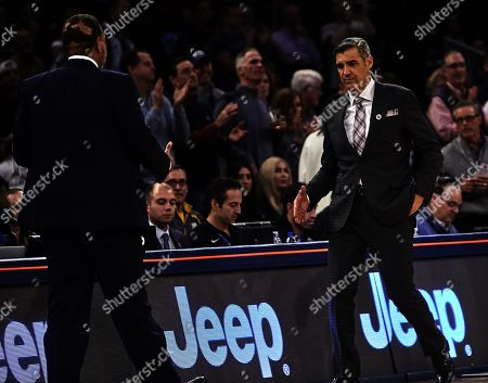 Stock Photo of New York, New York, U.S. - Villanova Wildcats head coach Jay Wright and Providence Friars head coach Ed Cooley shake after the Big East Tournament quarterfinals at Madison Square Garden in New York City. Villanova defeated Providence 73-62
