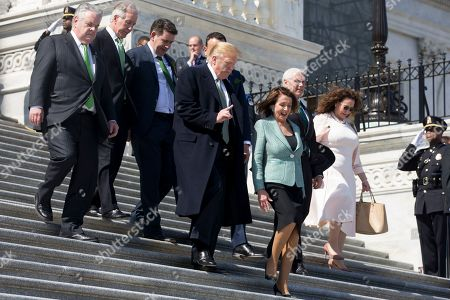 US President Donald Trump (Front L) and US Speaker of the House Nancy Pelosi (Front R) walk down the East Front House steps of the US Capitol following the Friends of Ireland luncheon in Washington, DC, USA, 14 March 2019. Also in the picture is Republican Representative from New York Peter King (L), Democratic Representative from Massachusetts Richard Neal (2-L), Irish politician John Deasy (3-L) and US Vice President Mike Pence (2-R).