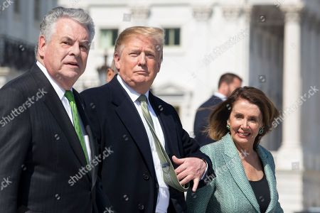 US President Donald Trump (C), US Speaker of the House Nancy Pelosi (R) and Republican Representative from New York Peter King (L) walk at the base of the East Front House steps of the US Capitol following the Friends of Ireland luncheon in Washington, DC, USA, 14 March 2019. President Trump attended the Friends of Ireland Luncheon on Capitol Hill ahead of St. Patrick's Day, which takes place 17 March.