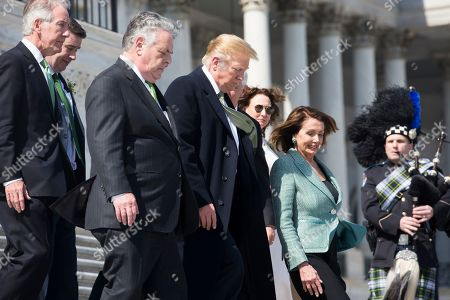 US President Donald Trump (C) and US Speaker of the House Nancy Pelosi (Front R) walk down the East Front House steps of the US Capitol following the Friends of Ireland luncheon in Washington, DC, USA, 14 March 2019. Also in the picture is Democratic Representative from Massachusetts Richard Neal (L) and Republican Representative from New York Peter King (2-L).