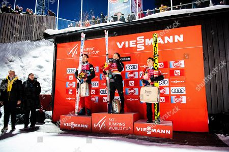 Ryoyu Kobayashi (C) of Japan stands on the podium after winning the FIS Ski Jumping World Cup in Trondheim, Norway, 14 March 2019. Kobayashi won ahead of second placed Andreas Stjernen (L) of Norway and third placed Stefan Kraft (R) of Austria.