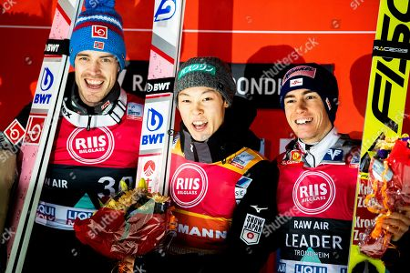 Ryoyu Kobayashi (C) of Japan celebrates on the podium after winning the FIS Ski Jumping World Cup in Trondheim, Norway, 14 March 2019. Kobayashi won ahead of second placed Andreas Stjernen (L) of Norway and third placed Stefan Kraft (R) of Austria.