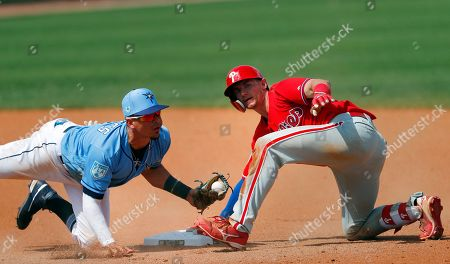 Rob Brantly, Willy Adames. Philadelphia Phillies' Rob Brantly (44) is tagged out at second base by Tampa Bay Rays shortstop Willy Adames (1) after trying to stretch a single in the seventh inning of a spring training baseball game, in Port Charlotte, Fla