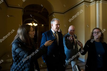 Republican Senator from North Carolina Thom Tillis (C) is followed by members of the news media after the Senate voted to block US President Donald J. Trump's national emergency declaration, on Capitol Hill in Washington, DC, USA, 14 March 2019. Tillis had previously said he would vote for the resolution but ended up voting against it. Passage of the resolution is considered an embarassment for the Trump administration as he will be forced to veto it, which will be the first veto of Trump's presidency.