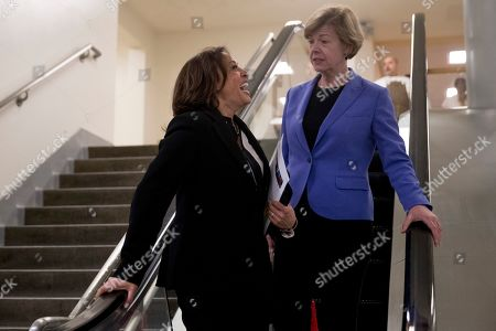 Stock Picture of Kamala Harris, Tammy Baldwin. Sen. Kamala Harris, D-Calif., left, and Sen. Tammy Baldwin, D-Wis., right, leave the U.S. Capitol Building on Capitol Hill in Washington
