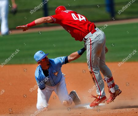 Philadelphia Phillies' Rob Brantly (44) is tagged out at second base by Tampa Bay Rays shortstop Willy Adames (1) after trying to stretch a single in the seventh inning of a spring training baseball game, in Port Charlotte, Fla