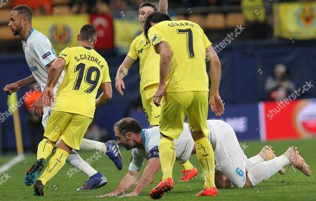 Zenit's Branislav Ivanovic falls during a Europa League round of 16, 2nd leg soccer match between Villarreal and Zenit St.Petersburg at the Ceramica stadium in Villarreal, Spain