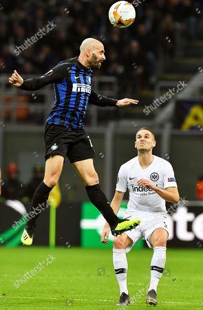 Inter Milan's midfielder Borja Valero (L) in action against Eintracht Frankfurt's Mijat Gacinovic (R) during the UEFA Europa League round of 16, second leg soccer match between Inter Milan and Eintracht Frankfurt in Milan, Italy, 14 March 2019.