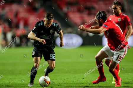 Benfica's Yuri Ribeiro (2-R) and Andrija Zivkovic (R) in action against GNK Dinamo Zagreb's Damian Kadzior (L) during their UEFA Europe League round of 16 second leg soccer match between SL Benfica and GNK Dinamo Zagreb, at Luz Stadium, in Lisbon, Portugal, 14th March 2019.