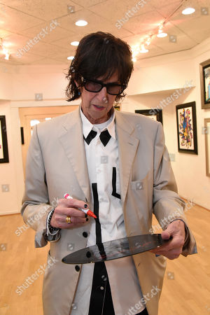 Stock Image of Rick Ocasek attends a media event prior to his art show 'Abstract Reality' at Wentworth Gallery on in Fort Lauderdale, Fla