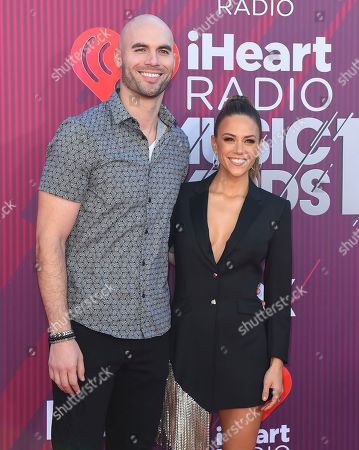 Jana Kramer, Mike Caussin. Jana Kramer, right, and Mike Caussin arrive at the iHeartRadio Music Awards, at the Microsoft Theater in Los Angeles