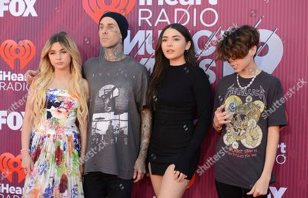 Stock Photo of Alabama Luella Barker, Travis Barker, Atiana De La Hoya, Landon Barker. Alabama Luella Barker, from left, Travis Barker, Atiana De La Hoya and Landon Barker arrive at the iHeartRadio Music Awards, at the Microsoft Theater in Los Angeles