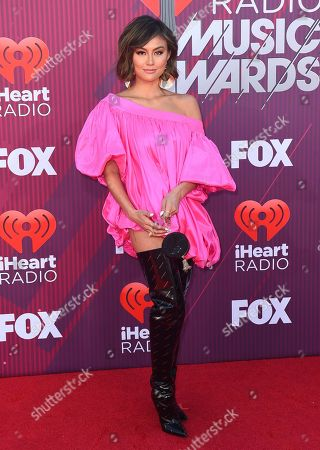 Agnez Mo arrives at the iHeartRadio Music Awards, at the Microsoft Theater in Los Angeles