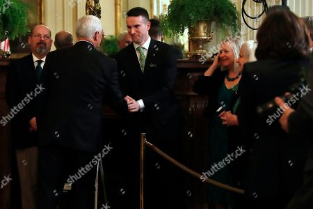 Matthew Barrett, Mike Pence. The partner of Irish Prime Minister Leo Varadkar, Matt Barrett, center, shakes hands with Vice President Mike Pence, after the annual presentation of a bowl of shamrocks in the East Room of the White House in Washington