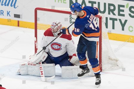 Stock Picture of Carey Price, Andrew Ladd. Montreal Canadiens goaltender Carey Price (31) makes a save against New York Islanders left wing Andrew Ladd (16) during the third period of an NHL hockey game, in Uniondale, N.Y