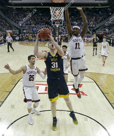 West Virginia's Logan Routt (31) shoots during the second half of the team's NCAA college basketball game against Texas Tech in the Big 12 men's tournament, in Kansas City, Mo. West Virginia won 79-74