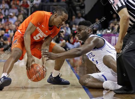 Stock Photo of Syracuse's Jalen Carey (5) and Duke's Zion Williamson (1) battle for a loose ball during the first half of an NCAA college basketball game in the Atlantic Coast Conference tournament in Charlotte, N.C