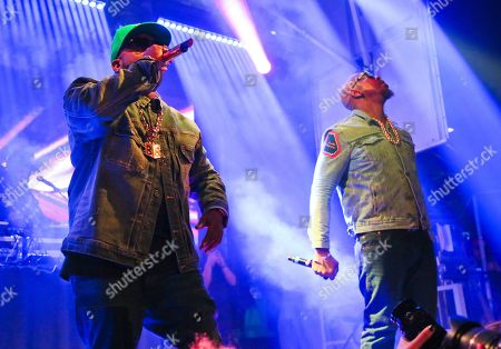 Stock Photo of Big Boi, Sleepy Brown. Big Boi, left, with Sleepy Brown, performs onstage at The Fader Fort during the South by Southwest Music Festival, in Austin, Texas