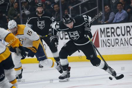 Los Angeles Kings forward Tyler Toffoli (73) controls the puck against Nashville Predators forward Craig Smith (15) during an NHL hockey game between Los Angeles Kings and Nashville Predators, in Los Angeles. The Predators won 3-1