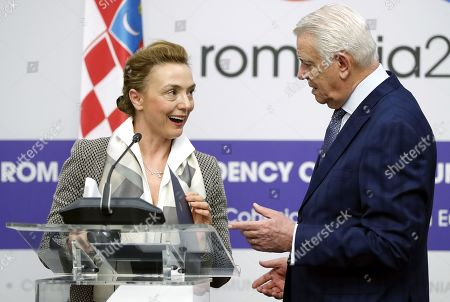 Deputy Prime Minister and Minister of Foreign and European Affairs of Croatia Marija Pejcinovic Buric chats with her Romanian counterpart Teodor Melescanu (R) after delivering a speech during a joint press conference at the end of their official meeting held at Foreign Ministry Headquarters in Bucharest, Romania, 15 March 2019.