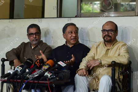 """President of Bangladesh Cricket Board Nazmul Hassan Papon, center, speaks during a press conference on the status of the country's cricket team after Friday's mass shootings in New Zealand, in Dhaka, Bangladesh, . Dozens of people were killed in mass shootings at two mosques full of worshippers attending Friday prayers on what the prime minister called """"one of New Zealand's darkest days."""" A cricket match between New Zealand and Bangladesh scheduled to start Saturday was canceled after the Bangladesh cricket team had a narrow escape"""