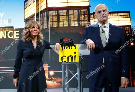 Eni CEO Claudio Descalzi, right, and Eni president Emma Marcegaglia pose for photographers prior to the start of the press conference during the 2019-22 ENI strategy presentation in San Donato Milanese, Milan, Italy, . Italian energy giant ENI says it will increase oil and gas production by 3.5 percent a year over its new 2019-2022 business plan, in line with the prior four years