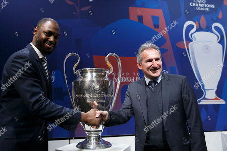 Ledley King (L) Ambassador of Tottenham Hotspur, shakes hands with Txiki Begiristain (R) Director of Manchester City FC after the drawing of the soccer matches for the UEFA Champions League 2018/19 quarter-finals at the UEFA headquarters in Nyon, Switzerland, 15 March 2019.