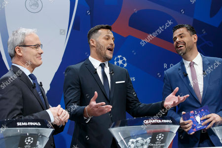 Brazilian former soccer player Julio Cesar, center, ambassador for the UEFA Champions League, jokes with UEFA deputy secretary general Giorgio Marchetti, left, and Pedro Pinto, right, Managing Director of Communications of UEFA, during the drawing of the soccer matches for the UEFA Champions League 2018/19 quarter-finals at the UEFA headquarters in Nyon, Switzerland, 15 March 2019.
