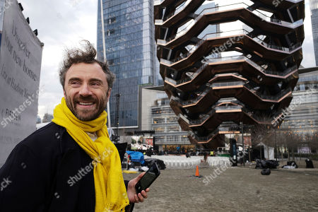 "British designer Thomas Heatherwick poses in front of ""Vessel"" before it opens to the public at Hudson Yards, in New York. Hudson Yards, a $25 billion urban complex on Manhattan's west side, is the city's most ambitious development since the rebuilding of the World Trade Center. When fully complete, the 28-acre site will include 16 towers of homes and offices, a shopping mall, hotel, school, the highest outdoor observation deck in the Western Hemisphere, a performing arts center and Vessel"