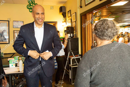 Democratic candidate for United States President Cory Booker (L) prepares to address voters at a campaign stop in Lebanon, New Hampshire, USA, 15 March 2019. Senator Booker is on a campaign tour of New Hampshire while pursing the Democratic nomination for United States President in the 2020 national election.