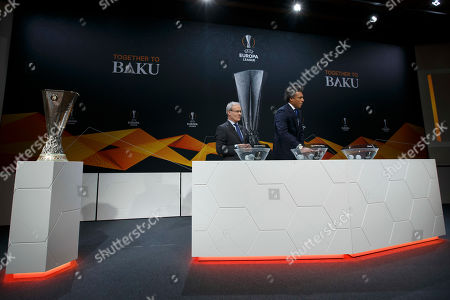 Dutch former soccer player Pierre van Hooijdonk (R), ambassador for the UEFA Europa League, and UEFA deputy secretary general Giorgio Marchetti during the drawing for the UEFA Europa League 2018/19 quarter-finals at the UEFA headquarters in Nyon, Switzerland, 15 March 2019.