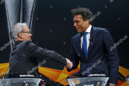 Dutch former soccer player Pierre van Hooijdonk (R), ambassador for the UEFA Europa League, and UEFA deputy secretary general Giorgio Marchetti shake hands during the drawing for the UEFA Europa League 2018/19 quarter-finals at the UEFA headquarters in Nyon, Switzerland, 15 March 2019.