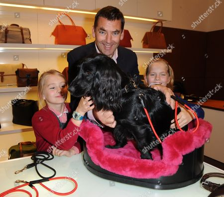 Bill Amberg and daughters with their dog